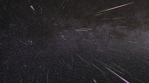 A photograph of meteors streaking through the sky, taken during the Perseid meteor shower.