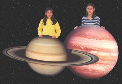 Girls with Saturn and Jupiter cutouts