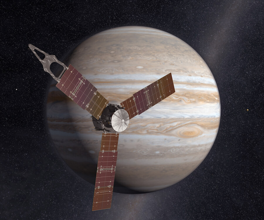 An artist's concept of the Juno spacecraft in front of Jupiter.
