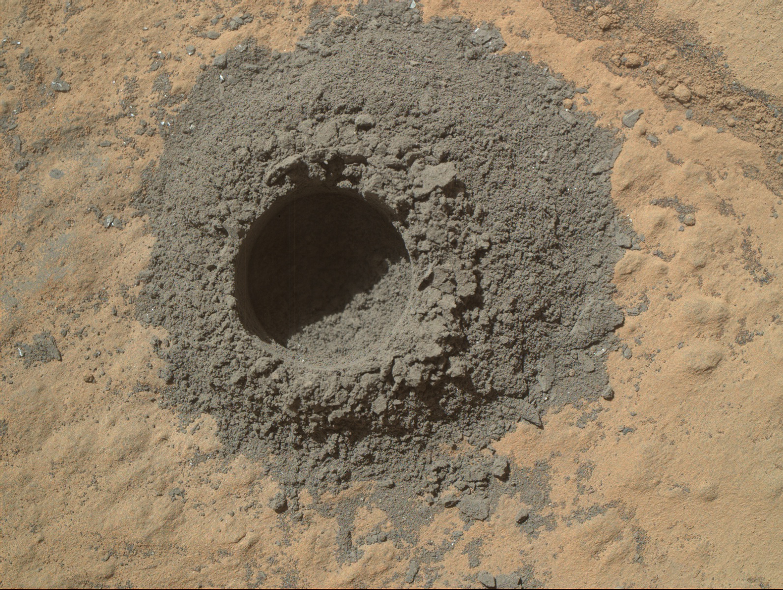 a hole in Martian rock drilled by Curiosity