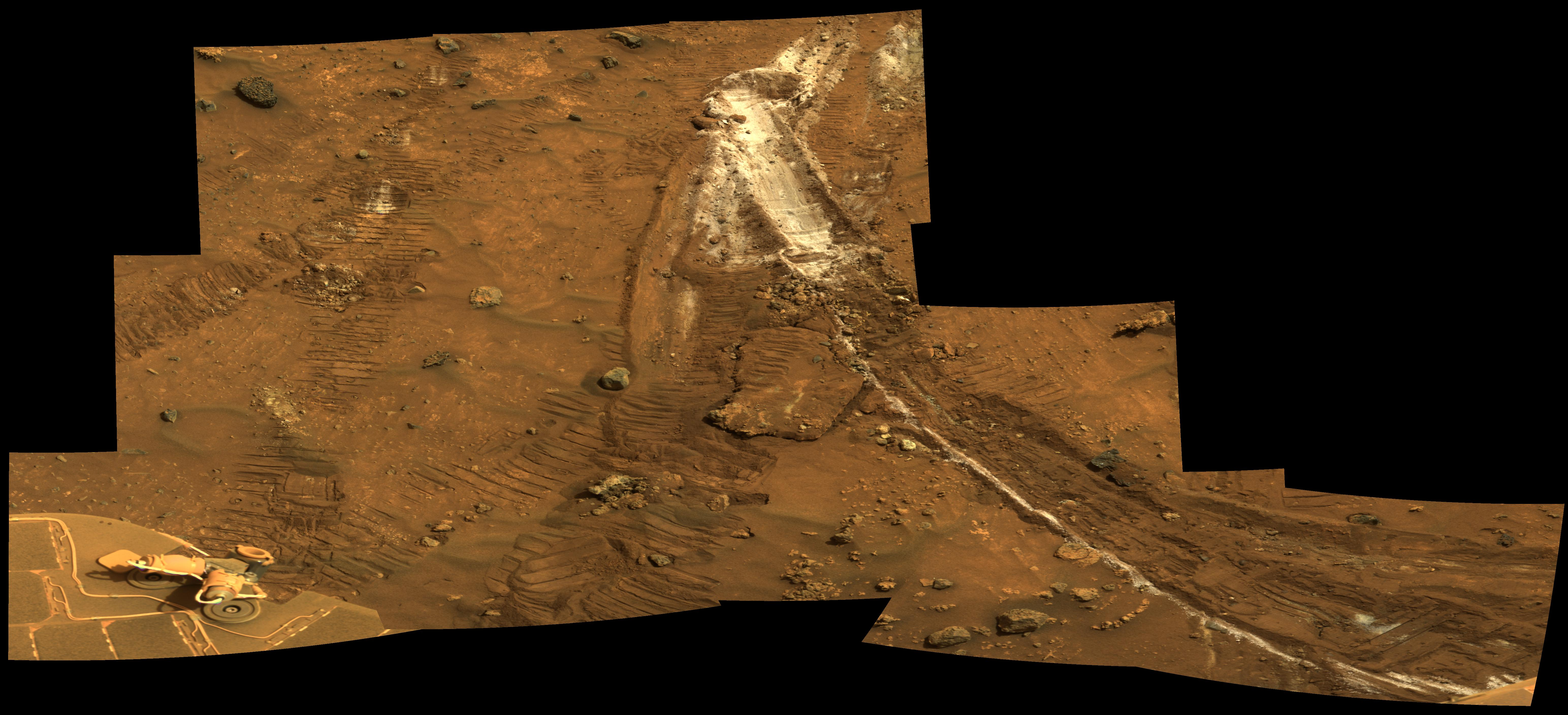 a white wheel mark in the Martian soil shows a spot where Spirit came across the mineral silica