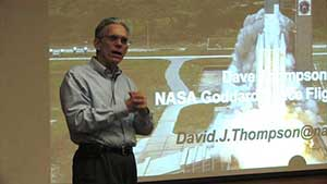 Dr. Thompson gives a talk at a conference of the American Astronomical Society.