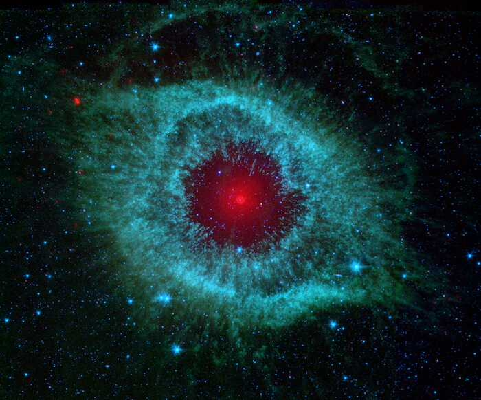 A red and blue image of the Helix Nebula.