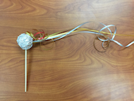 a photo of the craft activity comet on a stick made of tin foil and ribbon