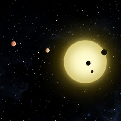 an illustration of a star with 4 orbiting planets