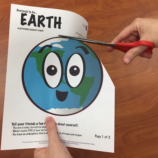 A piece of paper with an illustrated Earth on it.