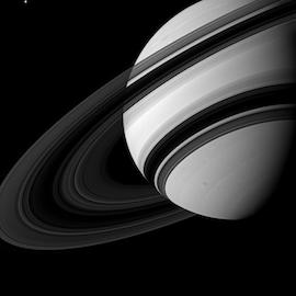Black and white image of Saturn and its rings.