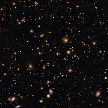 Image from the Hubble Space Telescope that shows galaxies that are very far away as they existed a very long time ago.