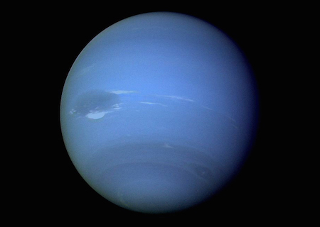 A photo of a full side of Neptune, showing a light blue color and dark bands near the southern pole.