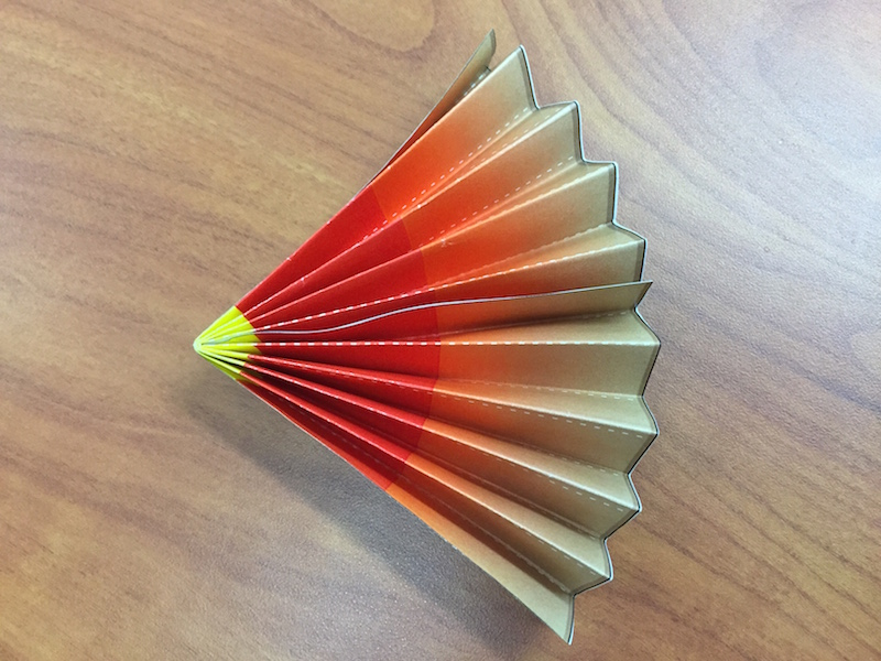 the fan is glued together, making a pie piece shape or wedge