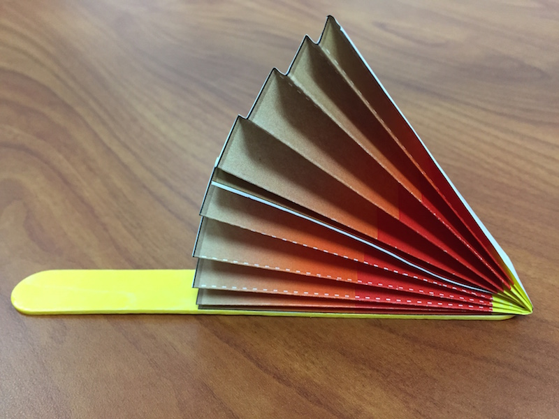 a photo of the first fan wedge glued to a popsicle stick