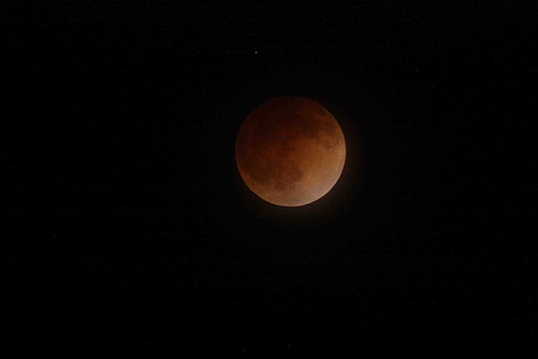 A blood moon against the night sky.