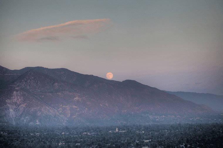 A 'Harvest Moon' rising over the foothills of the San Gabriel Mountains.