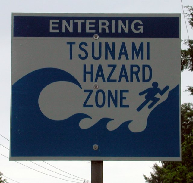 A sign that reads 'entering tsunami hazard zone.'