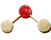 Two white (hydrogen) gumdrops joined by half-toothpicks to one red (oxygen) gumdrop.