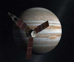 Artist's rendering of Juno spacecraft, with Jupiter in the background.