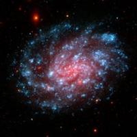 Image of a pink and blue spiral galaxy.