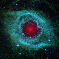 Image of an eye shaped nebula that is blue and red.