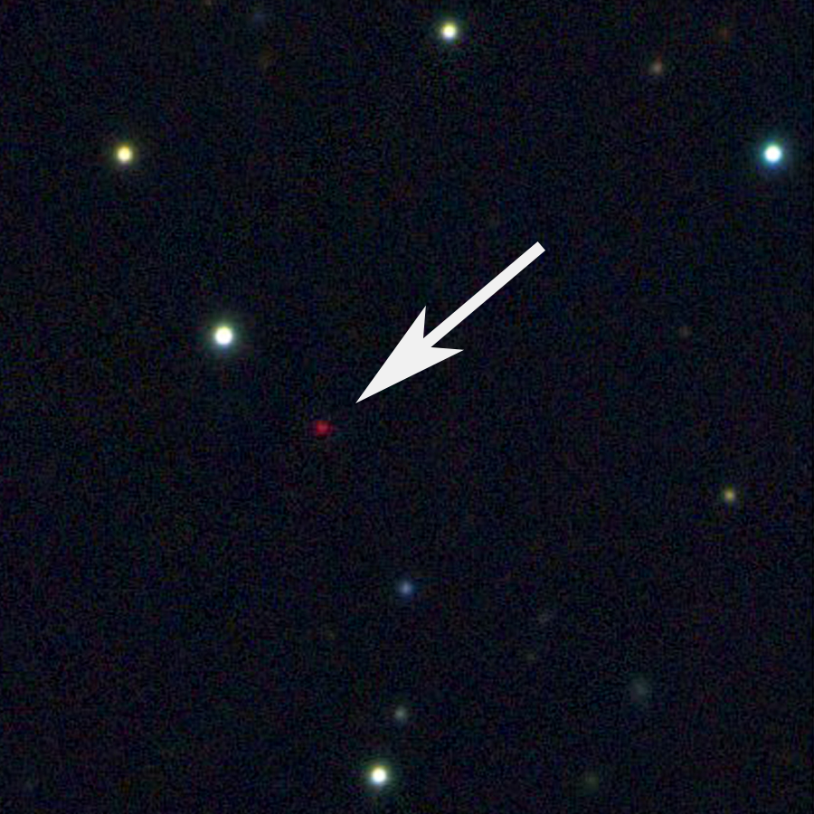 telescope image of the lone planet with an arrow pointing to it.