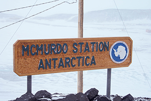 Sign says 'McMurdo Station, Anarctica.'