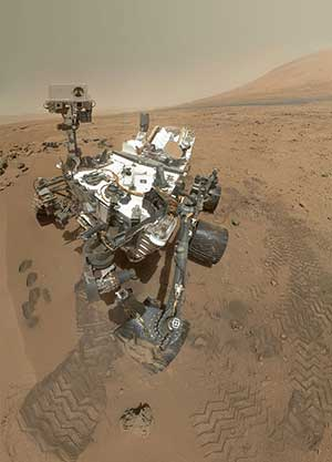 Somewhat distorted photo of Curiosity on Mars.