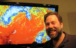 Photo of Tim Schmidt in front of colorful computer display.