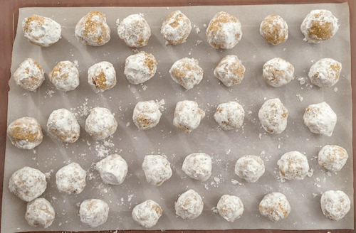 a tray of finished moon cookies sits on a tabletop.