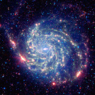 picture of the pinwheel galaxy taken in infrared so it looks red and blue.