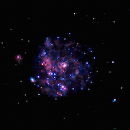 picture of the pinwheel galaxy taken with X-rays, so the pinwheel shape is not visible, but rather pink and purple spots.