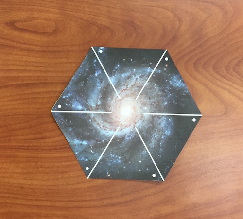 The cut out hexagonal shape of the pinwheel galaxy printout