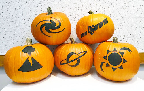 a picture of all the pumpkin designs: a galaxy, volcano, spacecraft, saturn, and sun