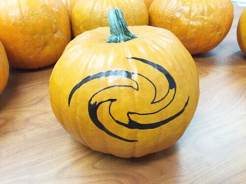 a partially filled in galaxy shape on a pumpkin