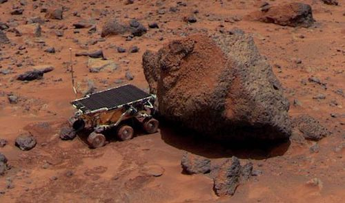 An image of the Soujourner rover exploring Martian terrain.